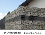 a modern form of house fencing. ... | Shutterstock . vector #1110167183