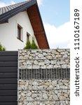 modern fence. a fragment of a... | Shutterstock . vector #1110167189