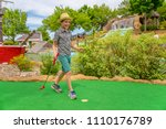 Young Golfer On The Mini Golf...