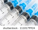 disposable syringe on white... | Shutterstock . vector #1110179924