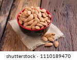almond nut in a ceramic bowl... | Shutterstock . vector #1110189470