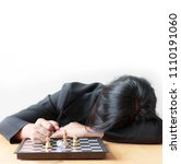 Small photo of Business woman face down on the table losing in game with chess board for business challenge metaphor and lose compitition concept on the white background with copy space