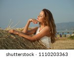 young woman standing in field... | Shutterstock . vector #1110203363