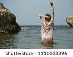 woman in wet shirt swimming in... | Shutterstock . vector #1110203396
