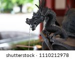 Statue Of Dragon Spraying The...