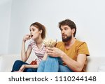 man and woman are sitting on... | Shutterstock . vector #1110244148