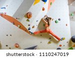 young woman climbing... | Shutterstock . vector #1110247019