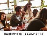 female professor talking to one ...   Shutterstock . vector #1110249443