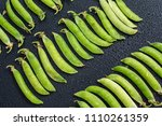 fresh green peas organized on... | Shutterstock . vector #1110261359