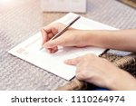 Small photo of Woman hands writing plan on notebook, planning agenda and schedule using calendar event planner. Calendar planner organization management remind concept.