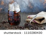 iced coffee in a glass jar with ... | Shutterstock . vector #1110280430