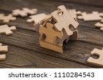 the house is made up of pieces... | Shutterstock . vector #1110284543