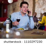 glad man talking on phone... | Shutterstock . vector #1110297230