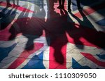shadows of people and uk flag... | Shutterstock . vector #1110309050