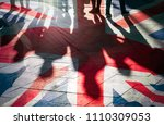 Shadows Of People And Uk Flag...