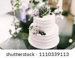 elegant white wedding cake with ... | Shutterstock . vector #1110339113