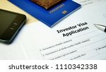 Small photo of Investor Visa Application form to travel or immigration. Document with passport, apply and permission for foreigner country