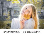 excited happy fall woman... | Shutterstock . vector #1110378344