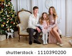 happy young family sitting... | Shutterstock . vector #1110390200