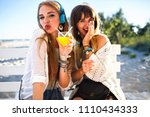 two happy funny hipster girls... | Shutterstock . vector #1110434333
