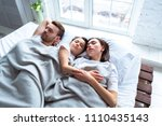 the happy parents with a girl... | Shutterstock . vector #1110435143