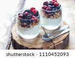granola with yogurt and berries ...   Shutterstock . vector #1110452093