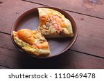 homemade pizza on a clay plate  ... | Shutterstock . vector #1110469478