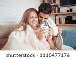 cute couple relaxing on couch... | Shutterstock . vector #1110477176