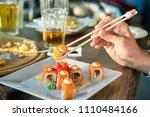 eating roll sushi in japanese...   Shutterstock . vector #1110484166