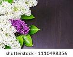a bouquet of lilac lies on a... | Shutterstock . vector #1110498356