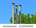 high triple chimney at the... | Shutterstock . vector #1110520466