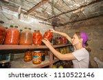woman puts jars with vegetables ... | Shutterstock . vector #1110522146