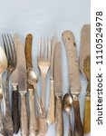 row of assorted tarnished... | Shutterstock . vector #1110524978