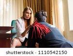 woman put whip on man shoulder | Shutterstock . vector #1110542150