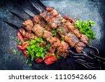 traditional russian shashlik on ... | Shutterstock . vector #1110542606