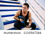 athlete man with biceps... | Shutterstock . vector #1110567266