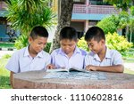 student reading and tutor by... | Shutterstock . vector #1110602816