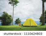 yellow tent alone in forest... | Shutterstock . vector #1110624803