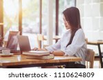 young businesswoman sitting at... | Shutterstock . vector #1110624809