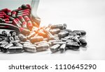 red and grey capsule pills on... | Shutterstock . vector #1110645290