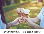 women hand holding an ice cream ... | Shutterstock . vector #1110654890