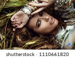 beautiful hippie girl lying in... | Shutterstock . vector #1110661820