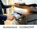 bussiness man hand press button ... | Shutterstock . vector #1110661949