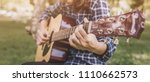 female fingers playing guitar... | Shutterstock . vector #1110662573