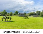 table with seating on a green... | Shutterstock . vector #1110668660
