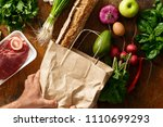 male hands hold paper bag of...   Shutterstock . vector #1110699293