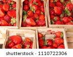 strawberries in wooden baskets...   Shutterstock . vector #1110722306
