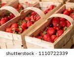 strawberries in wooden baskets...   Shutterstock . vector #1110722339