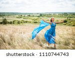 view of girl with flying blue... | Shutterstock . vector #1110744743