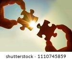 two hands of businessman to... | Shutterstock . vector #1110745859